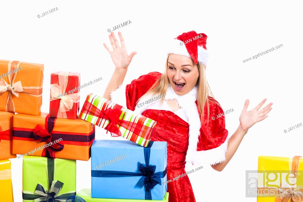Stock Photo: Surprised Christmas woman looking at many presents, isolated on white background.