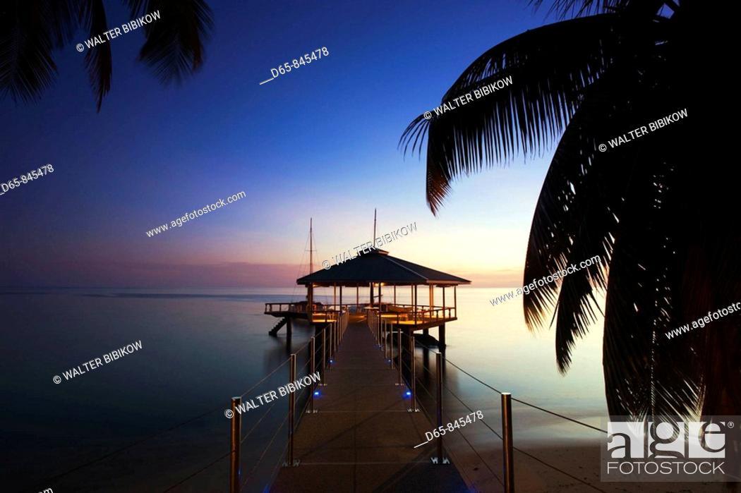 Stock Photo: Pier at Coco de Mer Hotel at sunset, Anse Bios de Rose, Praslin island, Seychelles.