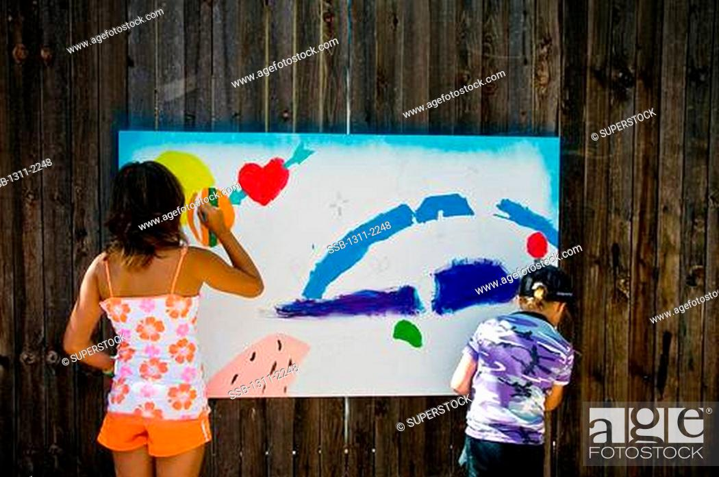 Photo de stock: Girls painting on a board in a chapel, Our Lady of Guadalupe Chapel, Albuquerque, New Mexico, USA.