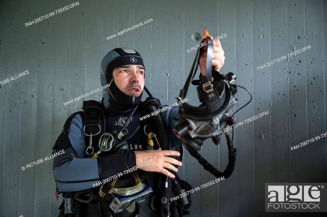 Stock Photo: 30 June 2020, Baden-Wuerttemberg, Schorndorf: Thomas Weller, group leader and training diver at the Stuttgart Water Police.
