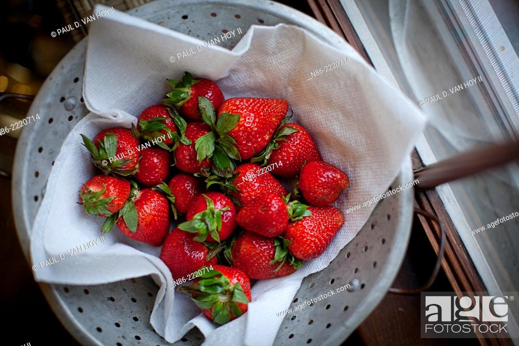 Stock Photo: fresh whole strawberries in colander.