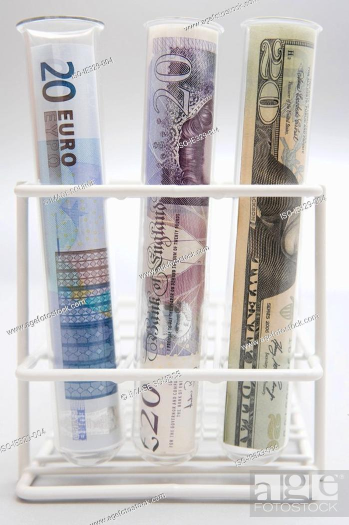 Stock Photo: Three banknotes in test tubes.