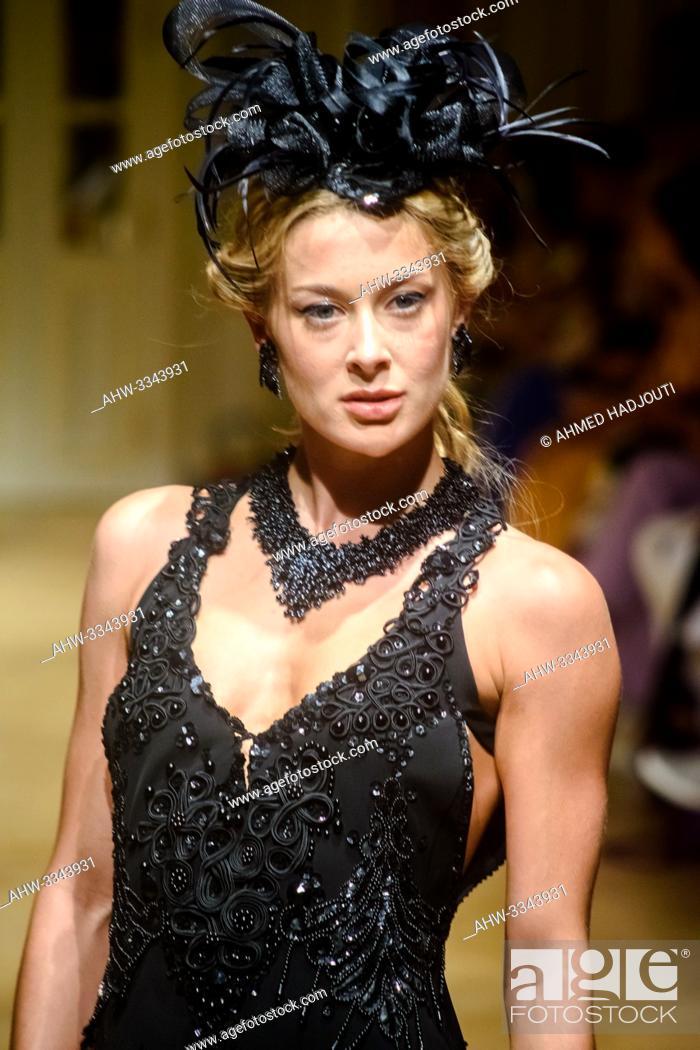 Stock Photo: PARIS, FRANCE - June 30 : A model walks the runway during the Slava Zaitsev Show As part of the Oriental Fashion Show during the Paris Fashion Week Haute.