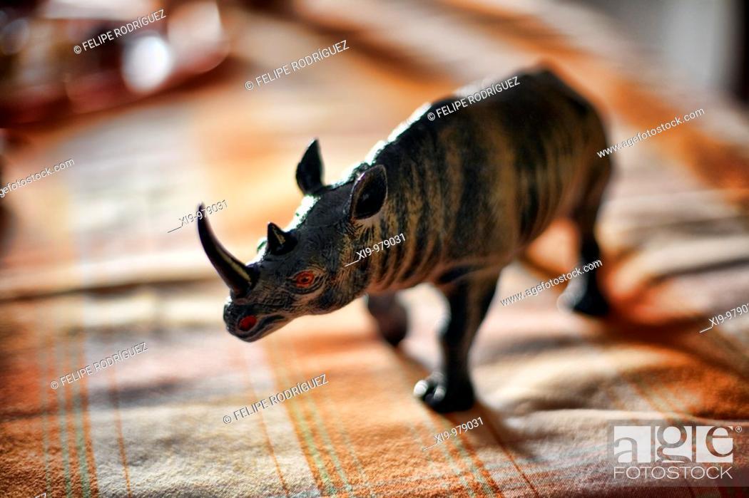 Stock Photo: Rhinoceros figure on a table, Seville, Spain.