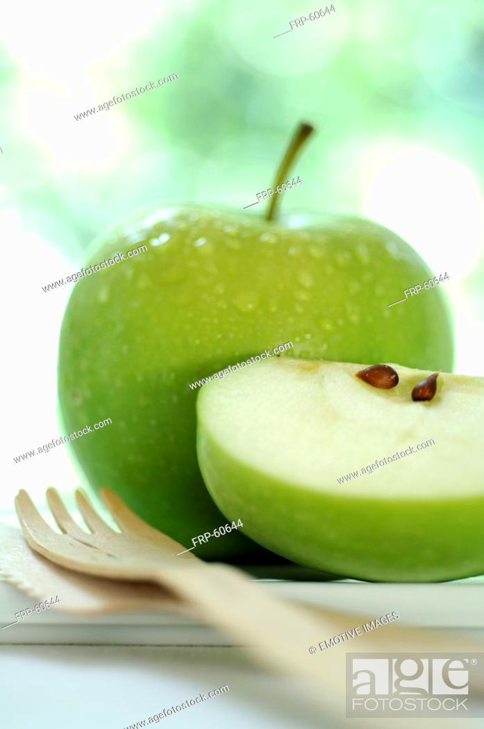 Stock Photo: Apple and a wooden fork.
