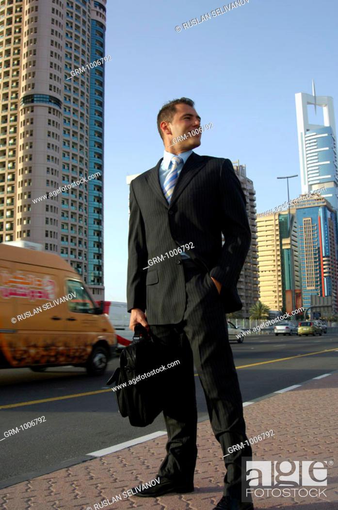 Stock Photo: Successful businessman in Dubai (on Shaikh Zayed Road).