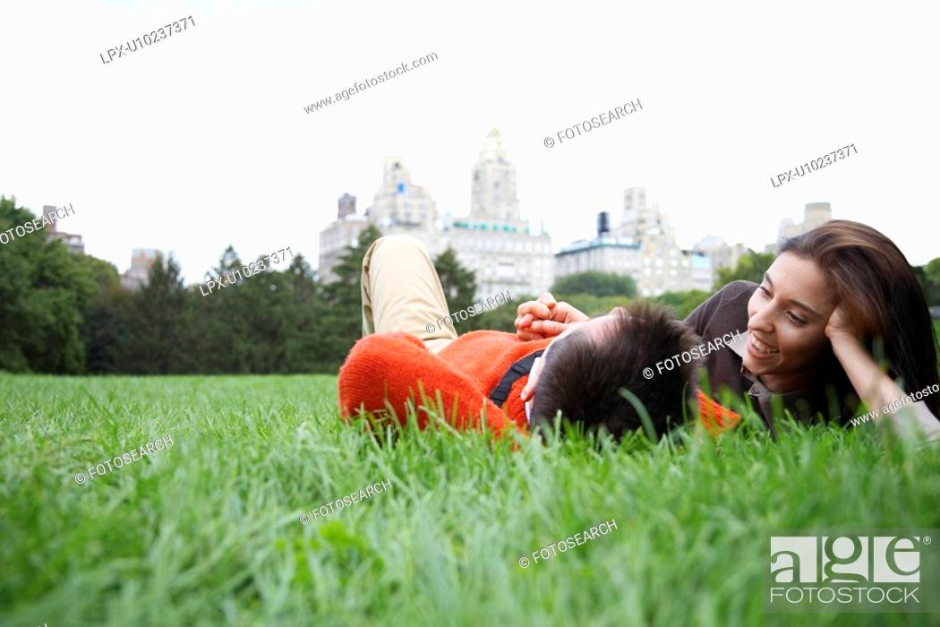 Stock Photo: Couple lying on grass low angle view.