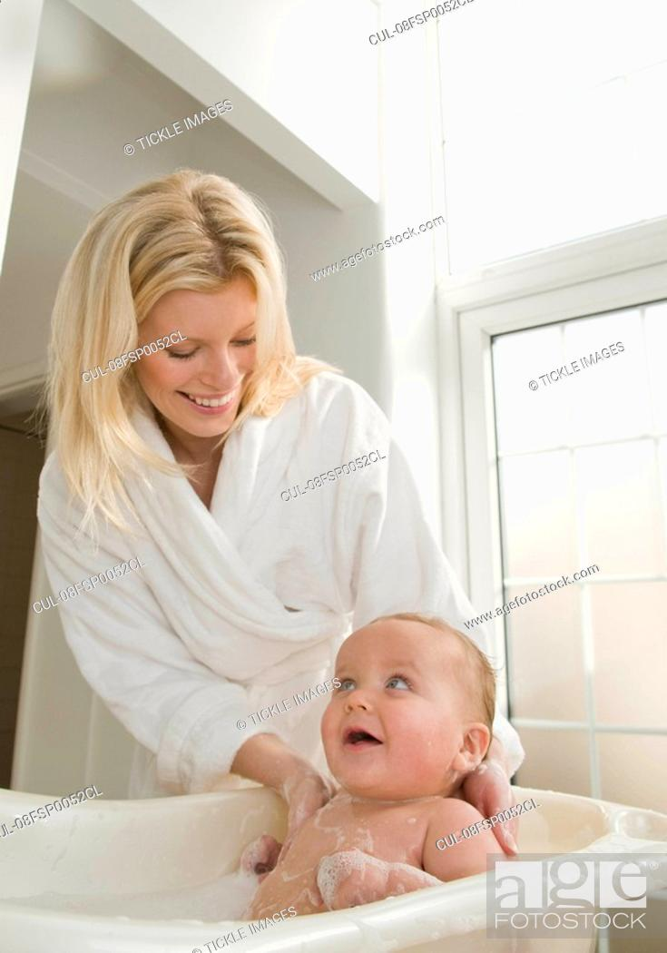 A mother bathing her baby boy, Stock Photo, Picture And Royalty Free ...