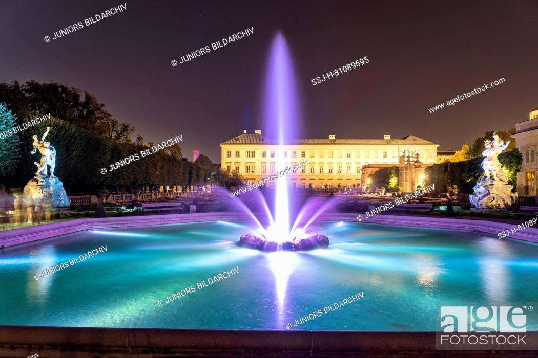 Stock Photo: Mirabell Palace at night with illuminated fountain. Salzburg, Austria.