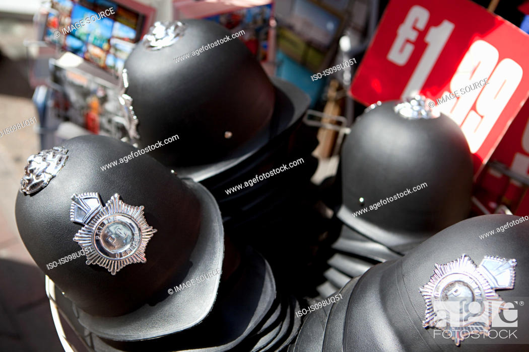 Stock Photo: Toy police helmets for sale, London.