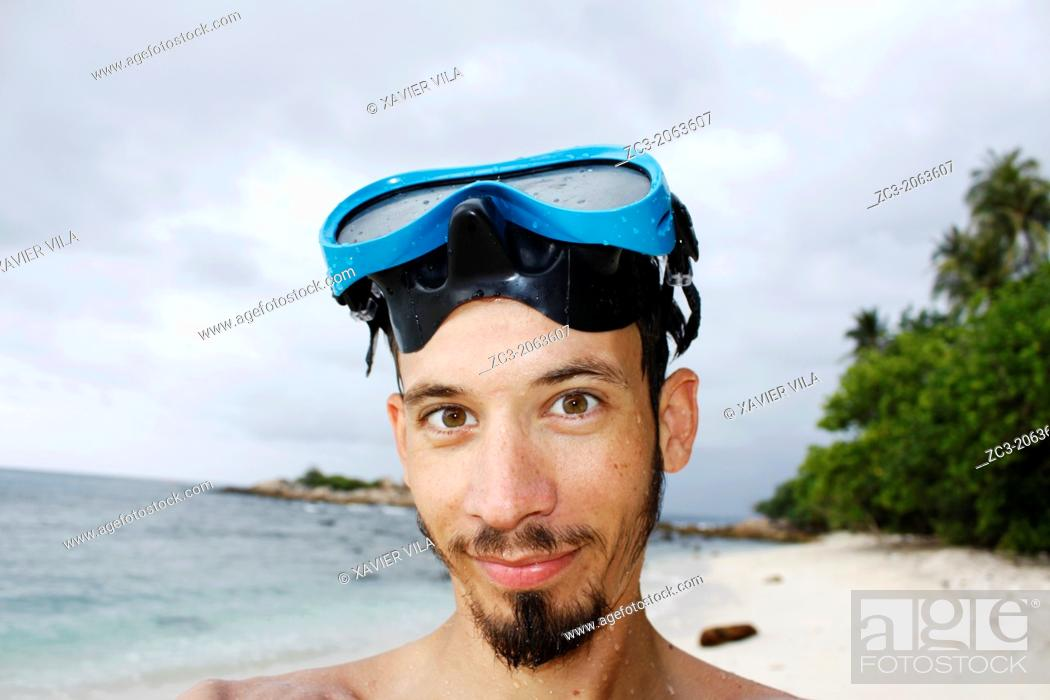 Stock Photo: Self-portrait of a man with a diving mask, Island Pulau Perhentian Kecil, China sea, Terengganu, Malaysia.