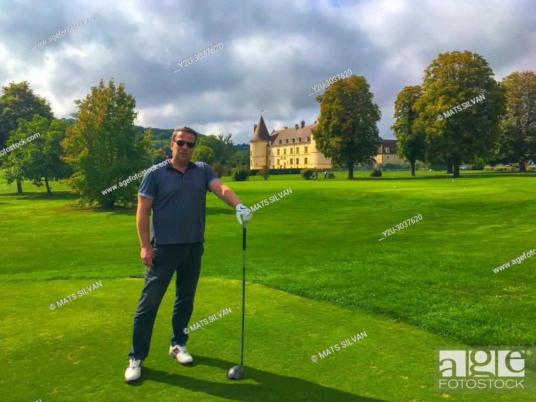 Stock Photo: Proud Golfer Holding his Driver in a Sunny Day with a Castle in background in Chailly-Sur-Armancon in France.