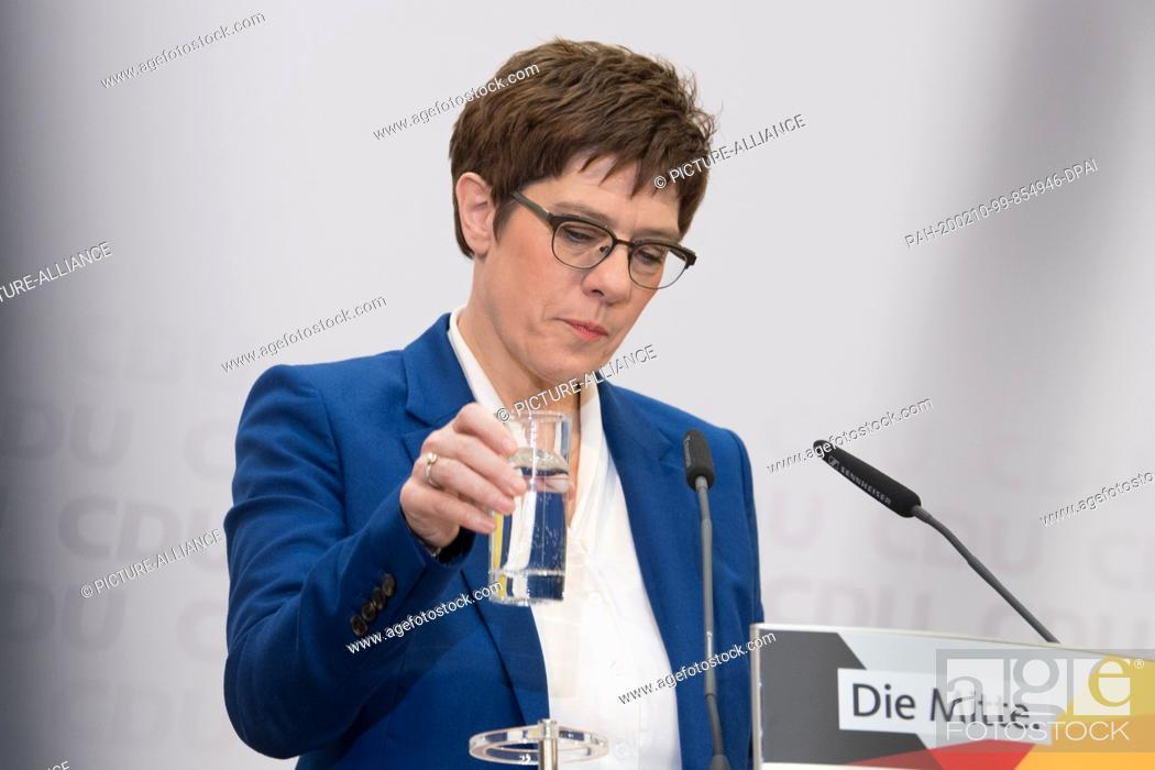 Stock Photo: 10 February 2020, Berlin: Annegret Kramp-Karrenbauer, chairwoman of the CDU, holds a glass of water at a press conference after the CDU committee meetings in.