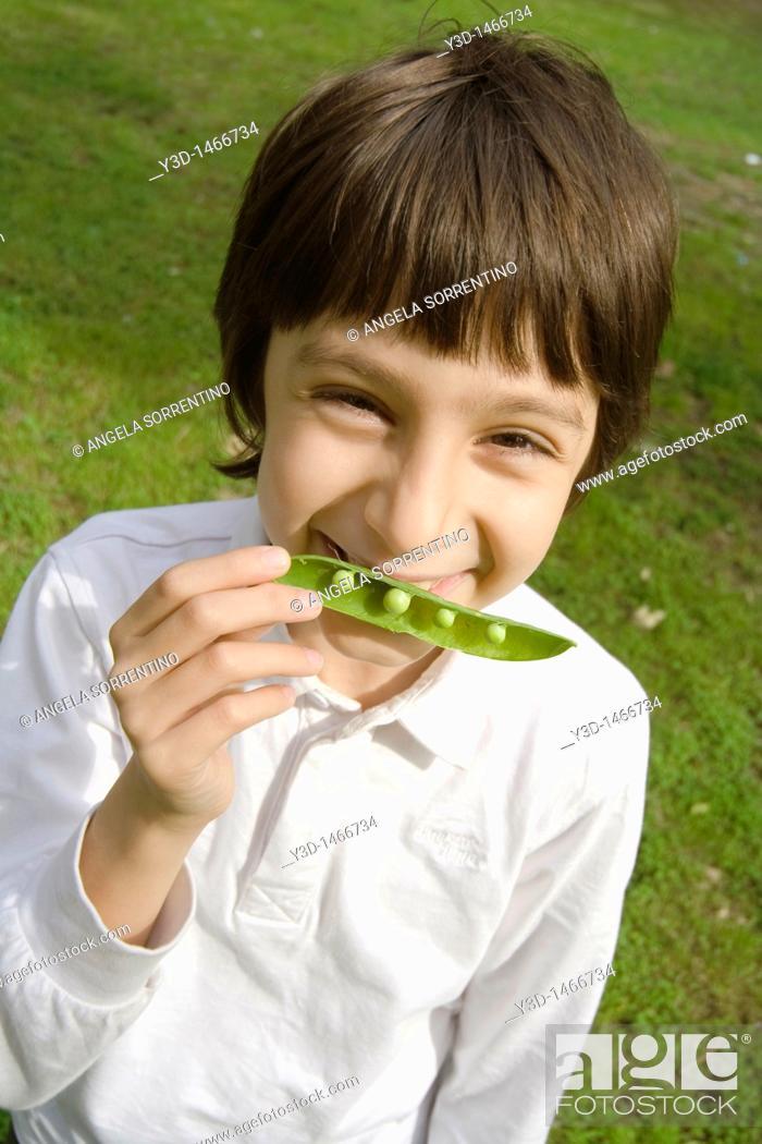 Stock Photo: Child Portrait with a Peas Pod.