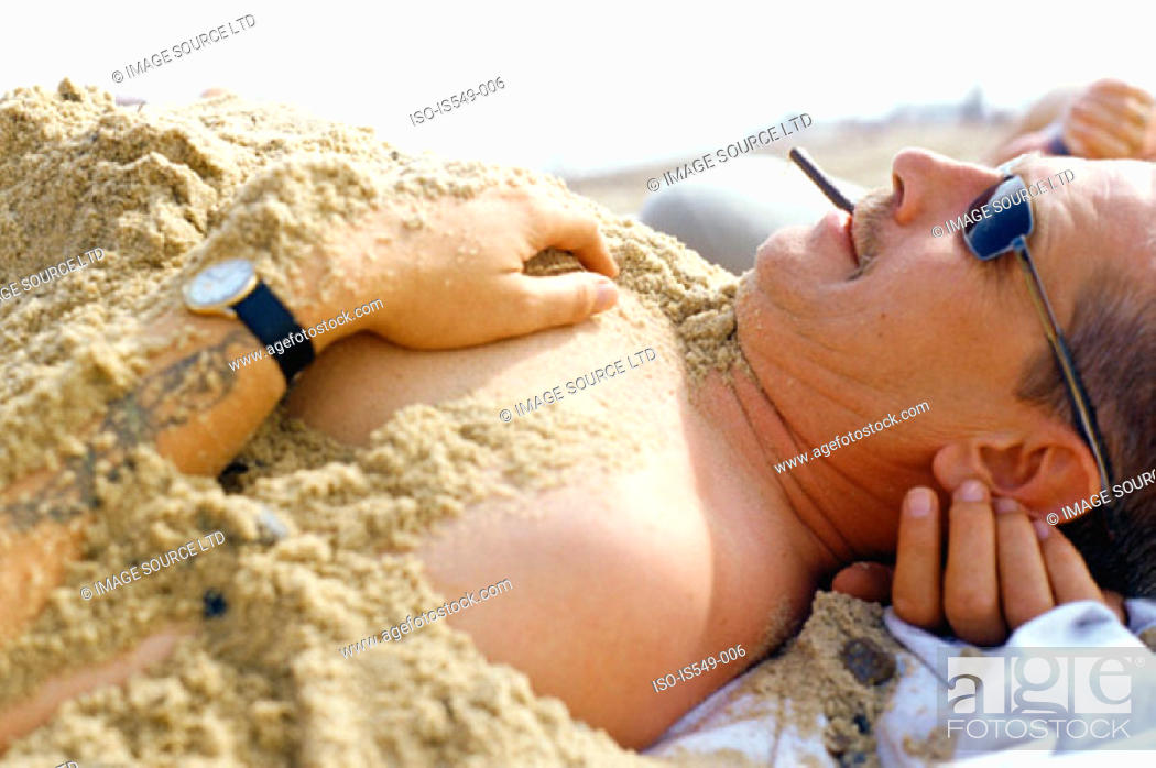 Stock Photo: Man covered in sand.
