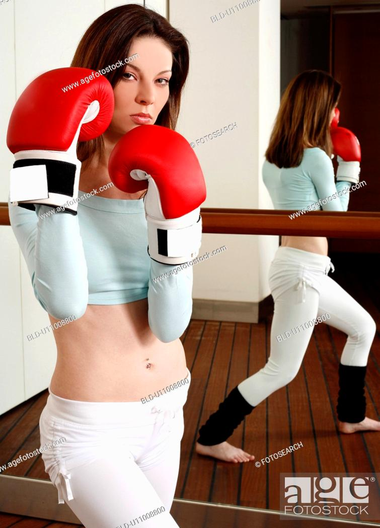Stock Photo: Young woman with boxing gloves.