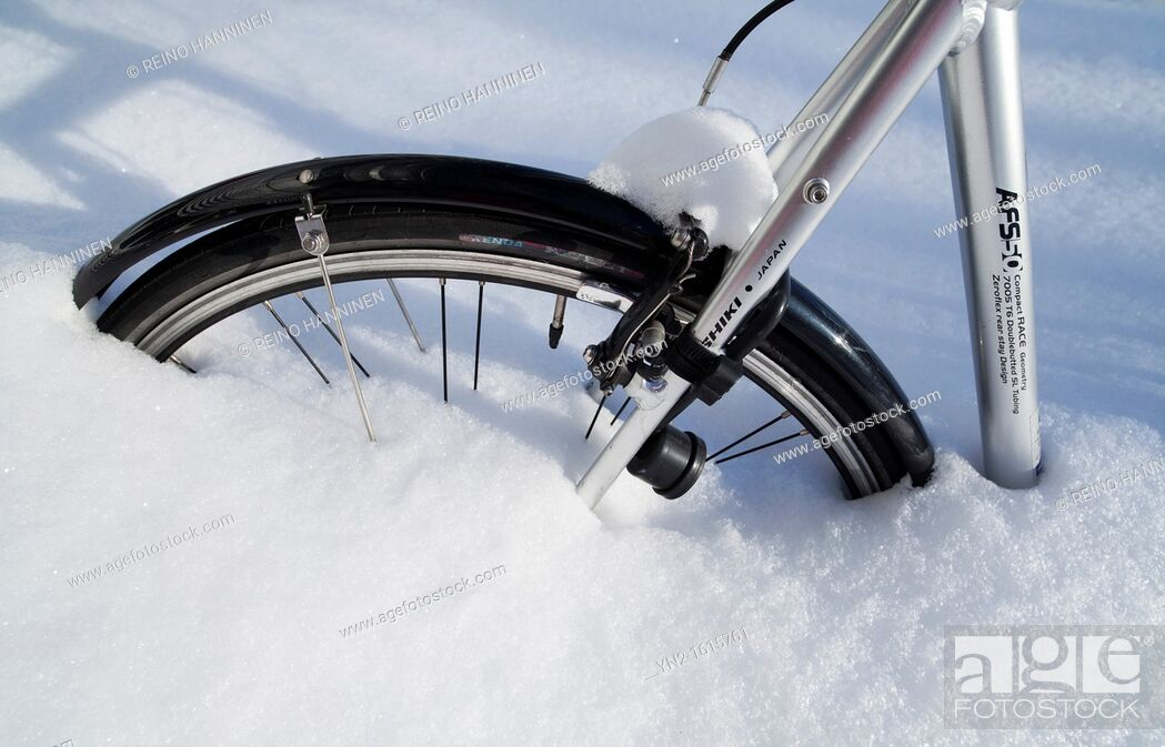Stock Photo: Bicycle wheel stuck in snowbank. Location Oulu Finland Scandinavia Europe.