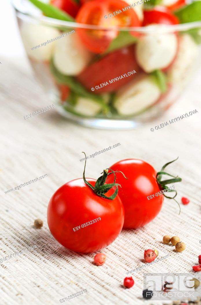 Stock Photo: Homemade Caprese salad in glass bowl.
