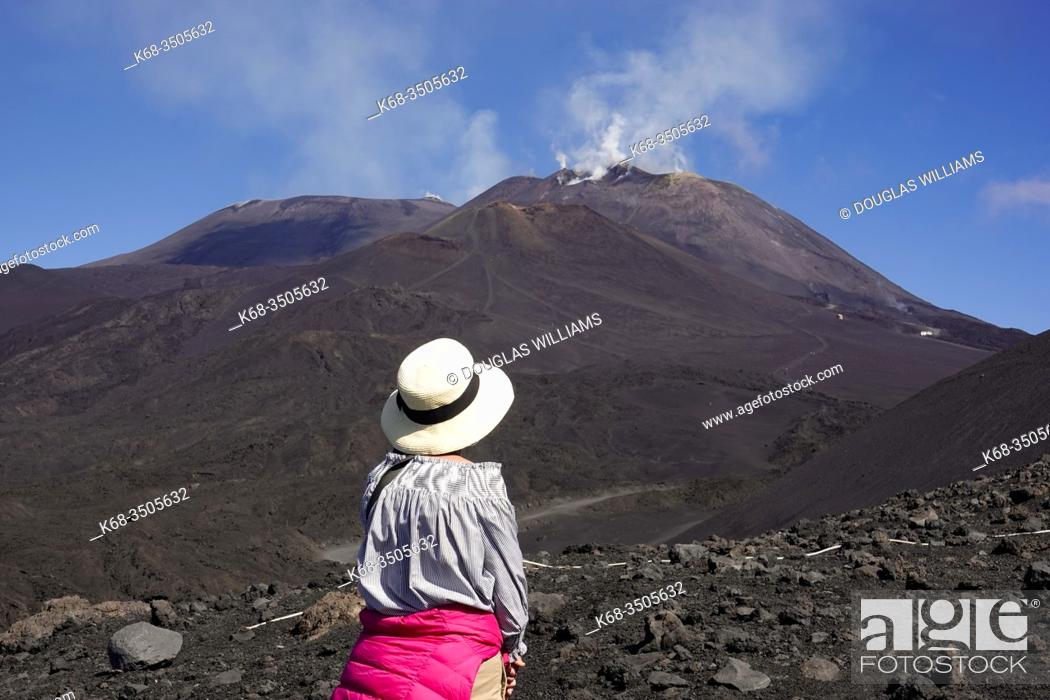 Stock Photo: Woman looks at Mount Etna, Sicily, Italy.