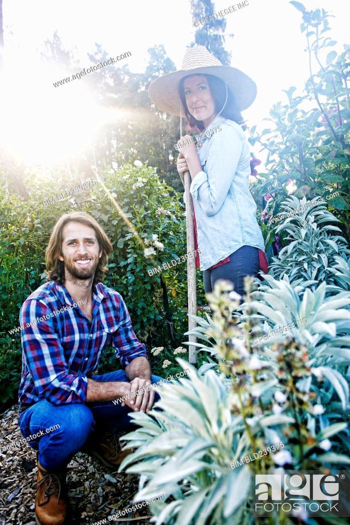 Stock Photo: Smiling Caucasian couple posing in garden.