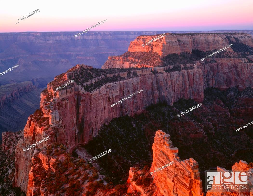Stock Photo: USA, Arizona, Grand Canyon National Park, North Rim, Sunrise light brightens Wotans Throne and surrounding canyon, from Cape Royal.
