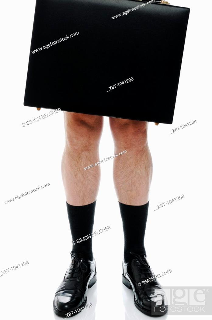 Stock Photo: Naked Businessman Holding a Briefcase, Low Angle, Cut Out.