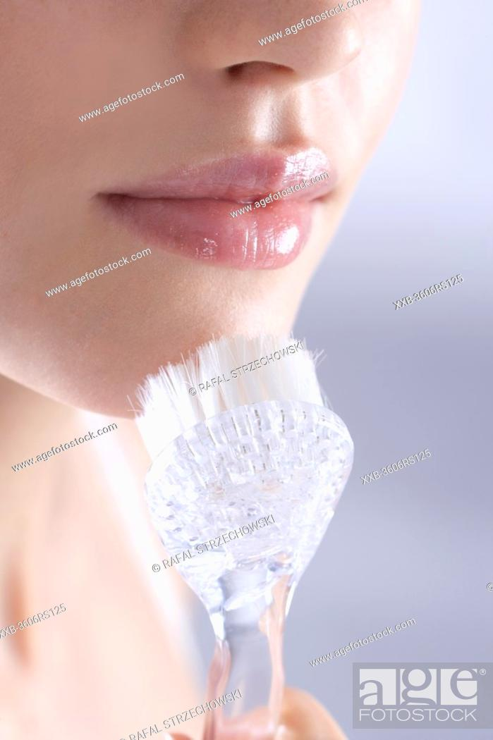 Stock Photo: woman with face cleaning brush.