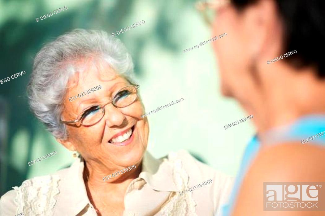 Stock Photo: Old friends, two happy senior women talking in park.