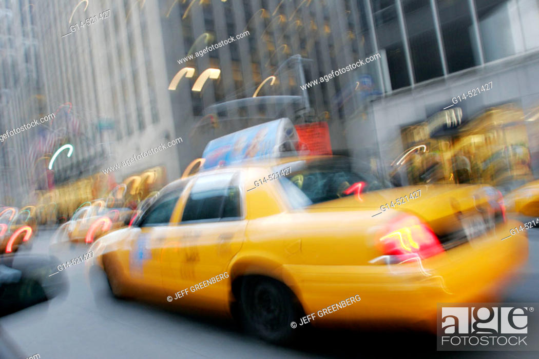 Stock Photo: Yellow taxi cabs, blur, motion, movement, speed. Avenue of the Americas. Midtown Manhattan. New York. USA.