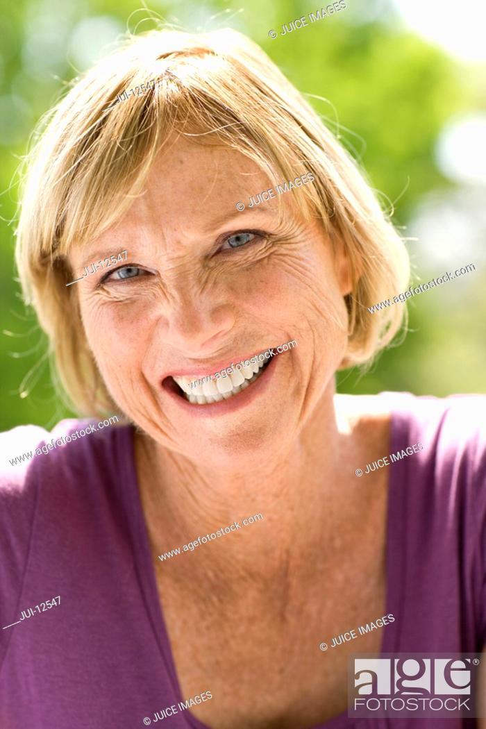 Stock Photo: Mature woman oudoors, smiling, portrait.