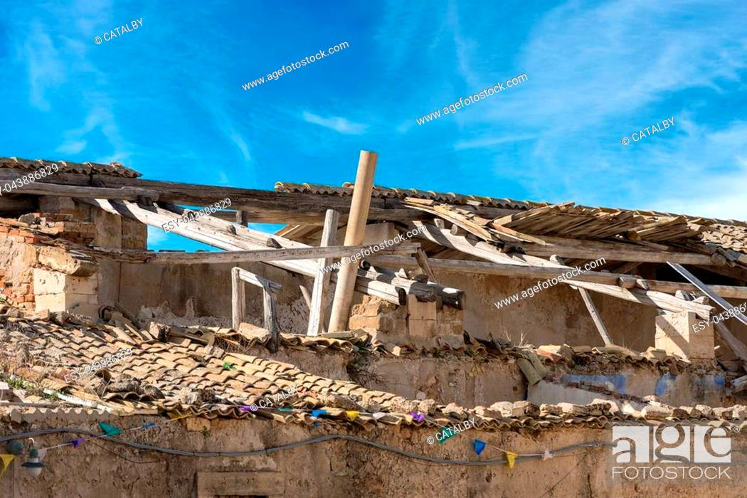 Stock Photo: Detail of a damaged and abandoned roof with broken tiles and beams.