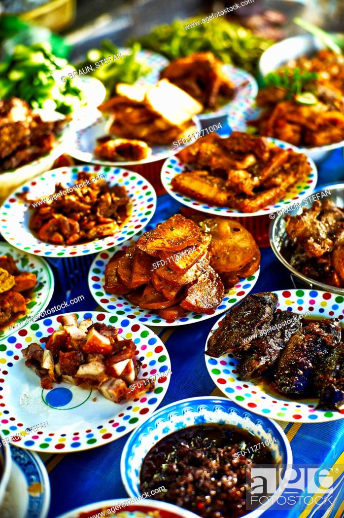 Stock Photo: Street food at a market in Saigon (Vietnam).