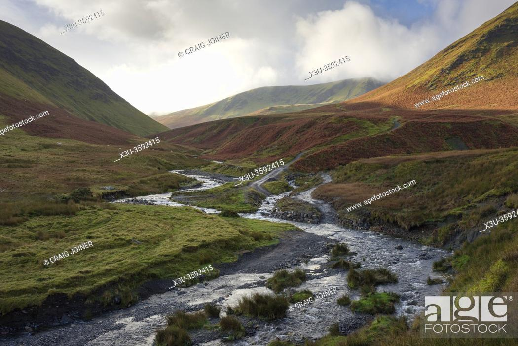 Stock Photo: The confluence of the River Glenderamackin and Bullfell Beck with Bannderdale Crags beyond in the Lake District National Park, Cumbria, England.