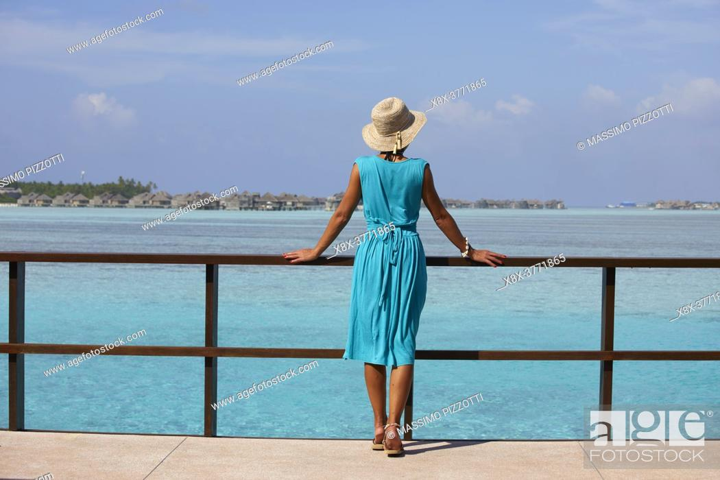Stock Photo: Young woman at the Paradise Island (Lankanfinolhu), Maldives.