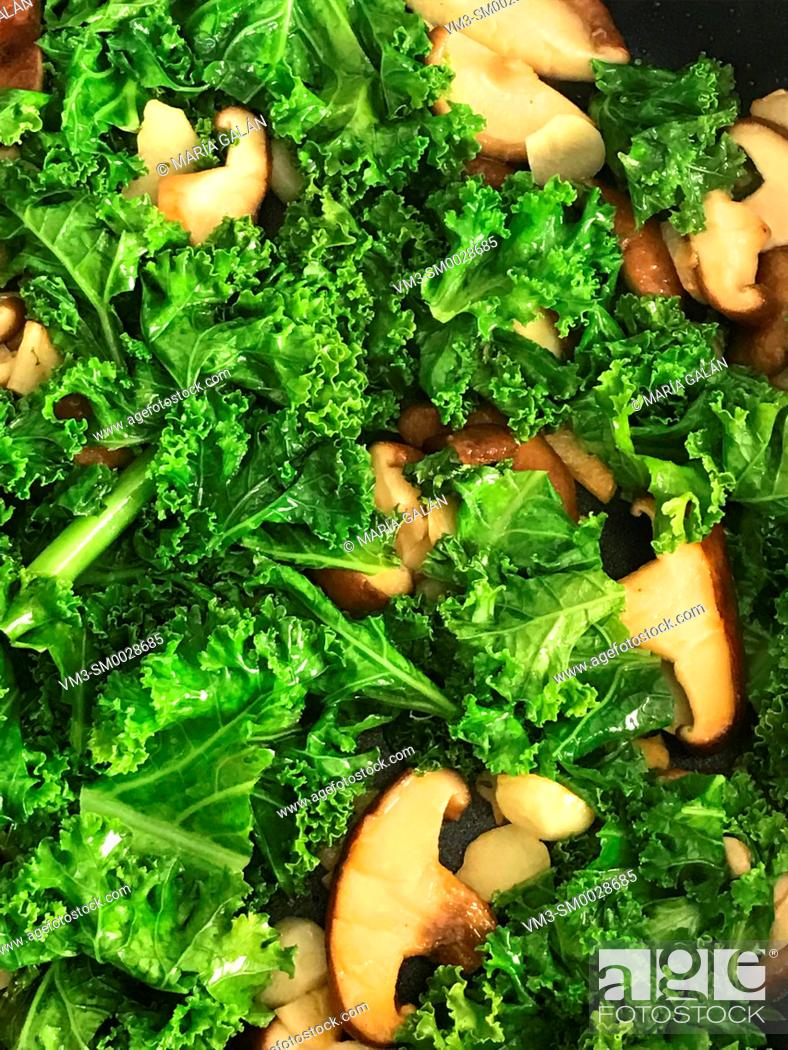 Stock Photo: Curly cabbage with mushrooms.
