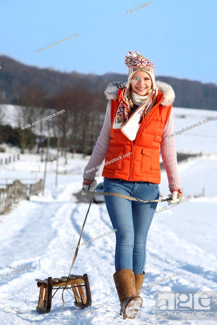 Stock Photo: young woman in winterly landscape.