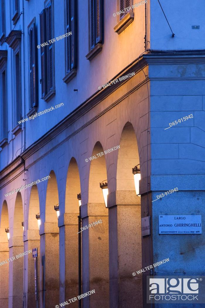 Stock Photo: Italy, Lombardy, Milan, Piazza Duomo area, buildings, evening.