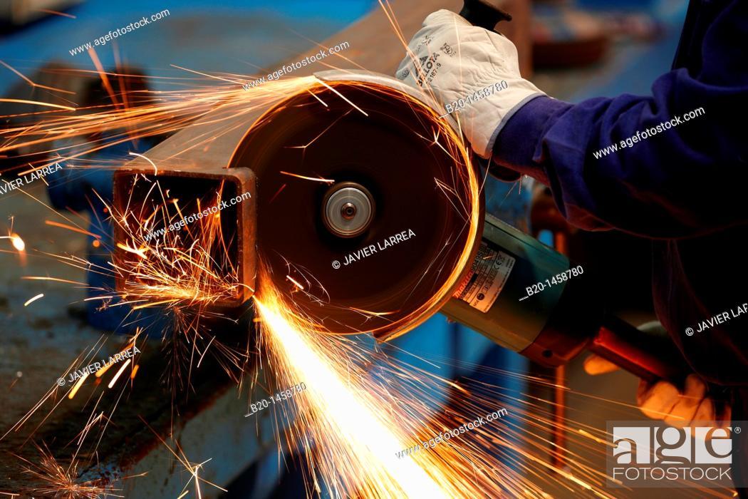Stock Photo: Cutting square hollow steel section, grinding machine with abrasive wheel, metallurgy, Legazpi, Gipuzkoa, Euskadi, Spain.
