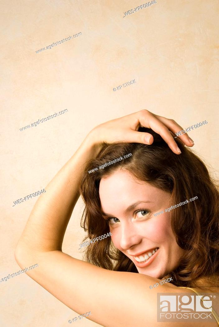 Stock Photo: Young woman, Hand in hair, portrait, close up.