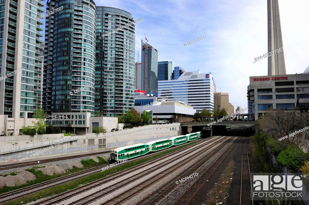 Stock Photo: train in centre of Toronto, Baseballstadion Rogers Centre an CN Tower in the background, Canada, Ontario, Toronto.