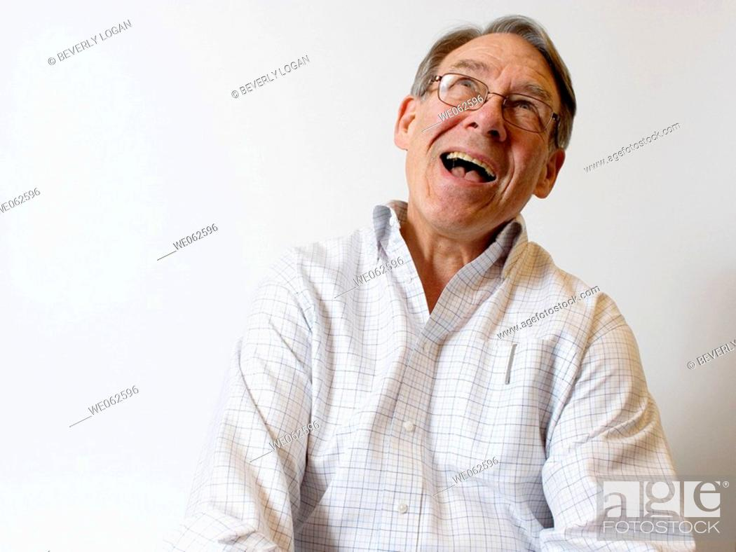 Stock Photo: Sixty-five-year old man smiling.