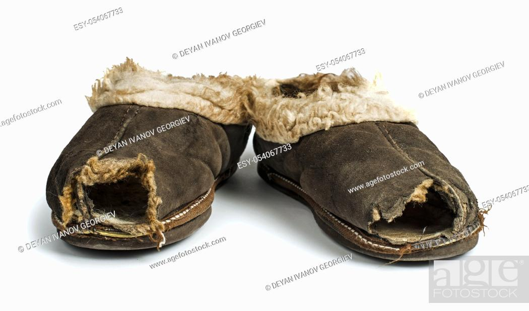 Stock Photo: Old torn boots of leather with a hole.