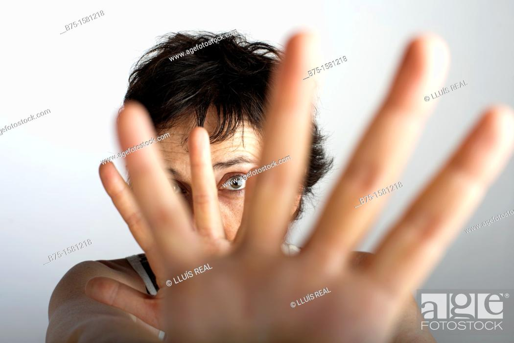 Stock Photo: Woman covering camera with her hands.