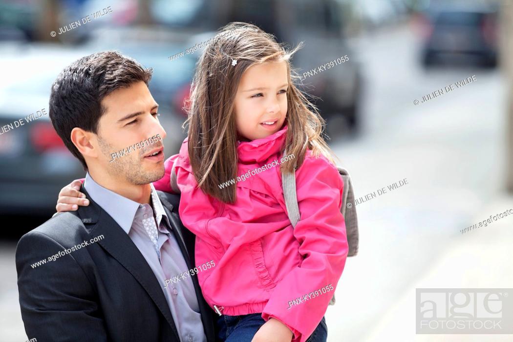 Stock Photo: Man carrying his daughter.