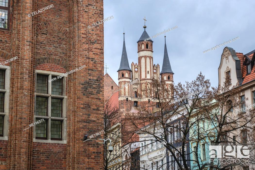 Stock Photo: Buildings around main square of Old Town in Torun, Kuyavian Pomeranian Voivodeship of Poland, view with Holy Spirit Church.