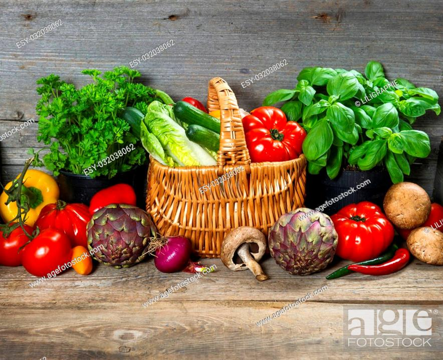 Stock Photo: fresh herbs and vegetables on wooden background. raw food ingredients. country style picture. selective focus.