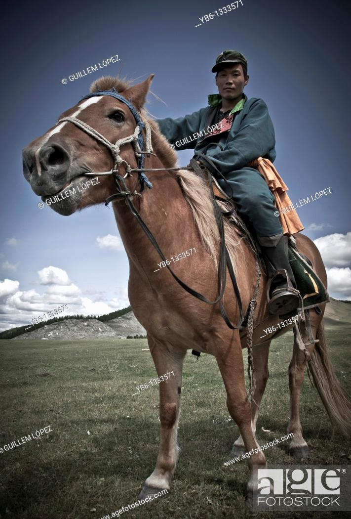 Stock Photo: Portrait of a Nomad with his horse in Northern Mongolia.
