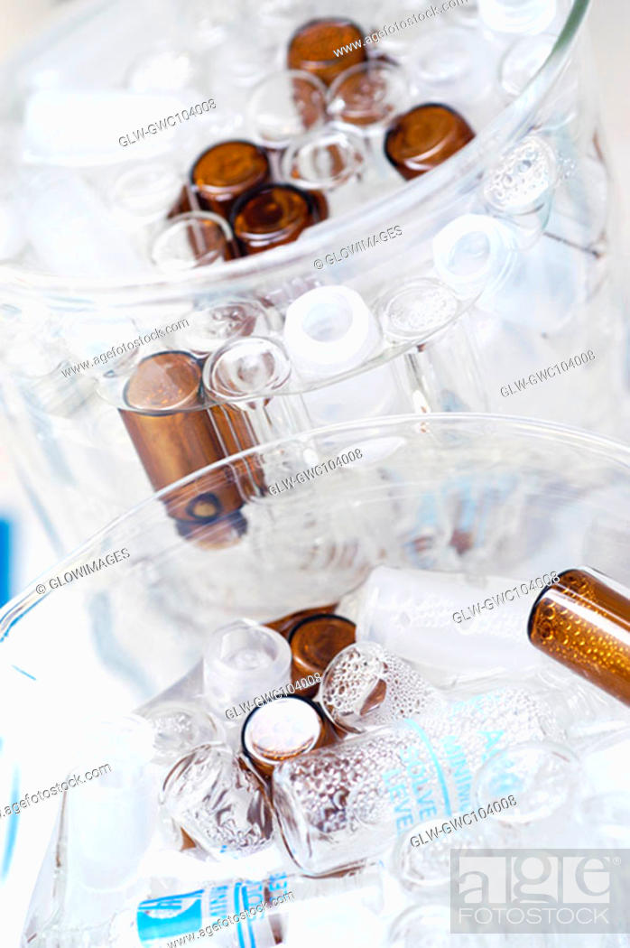 Stock Photo: High angle view of vials and bottles in glass containers.