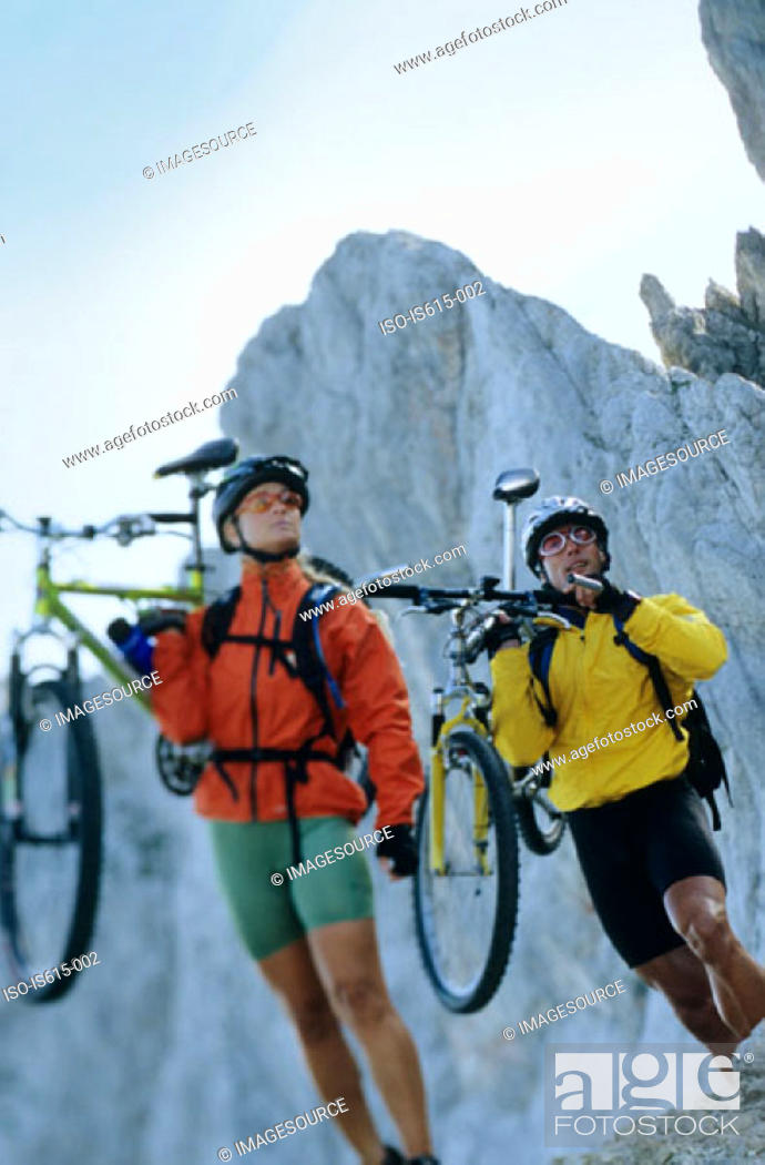 Stock Photo: Carrying bikes in the mountains.