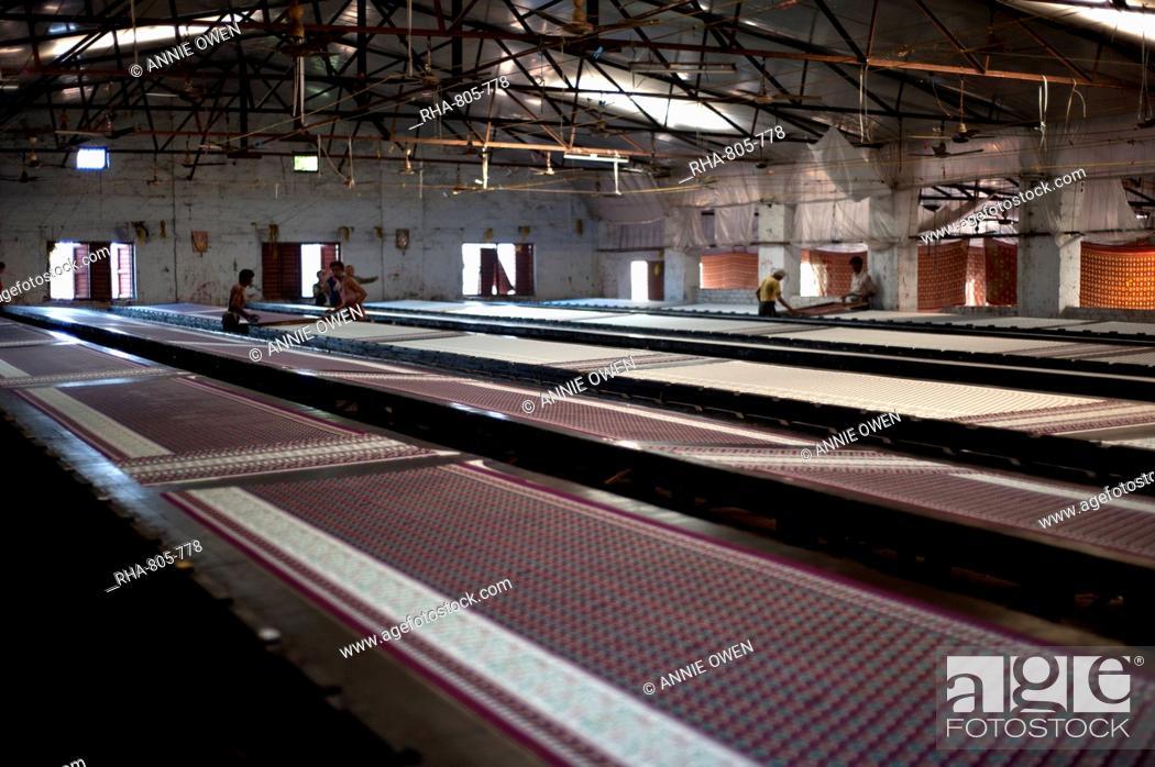 Stock Photo: Screenprinting factory, men printing sari lengths of cotton by hand, Bhuj district, Gujarat, India, Asia.